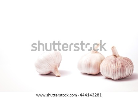 Spice for food. Garlic vegetable isolated on white background. Organic fresh ripe nutrition object. Part of healthy vitamin bulb. Spiciness natural plant closeup.  - stock photo