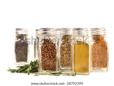 Spice jars with fresh rosemary leaves against white background - stock photo