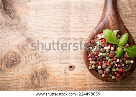 Spice mix a wooden spoon on a wooden background. - stock photo