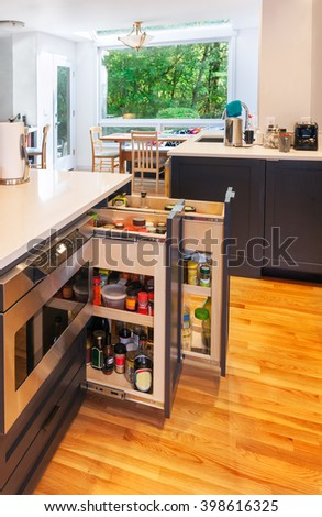 Spice pullouts in kitchen island as part of kitchen remodel - stock photo