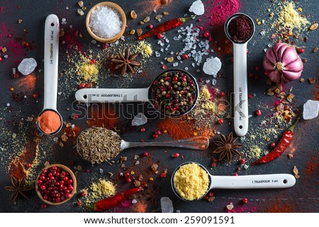 Spice selection from all around the world, on black background - stock photo