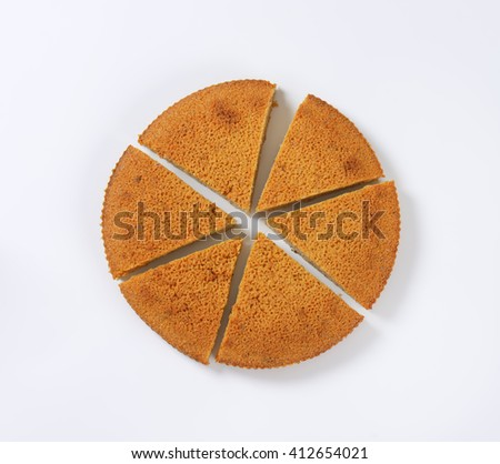 Spiced almond cake cut into slices - stock photo