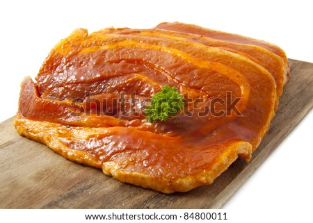 Spiced chops on wooden plate on a white background - stock photo