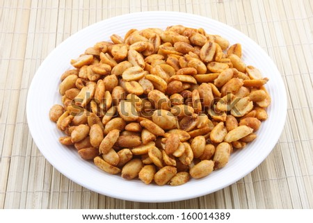 Spiced fried Peanuts-A popular all time snack. - stock photo
