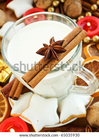 Spiced milk and homemade gingerbread cookies for Santa. Shallow dof. - stock photo