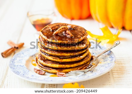 Spiced Pumpkin pancakes with maple syrup and pecan - stock photo