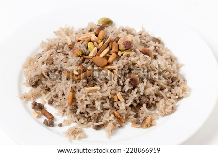 Spiced rice in the Lebanese or Arab style, toped with freshly roasted pine nuts - stock photo