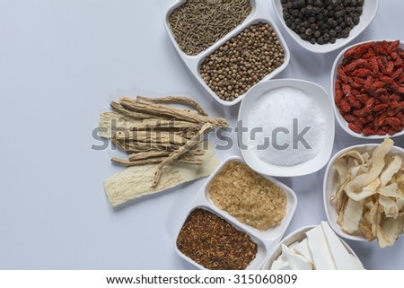 Spices and condiments for making soup, put on white cup./ Spices and condiments - stock photo