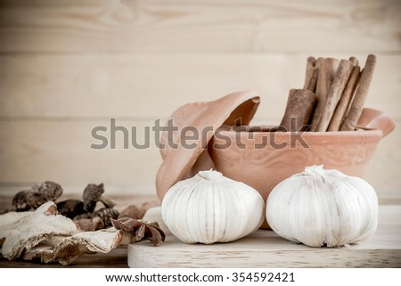 spices and flavorings on wood background. - stock photo
