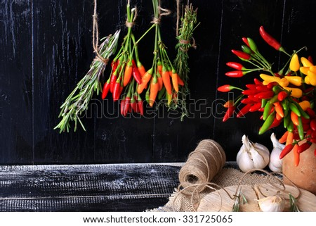 Spices and herbs  bunch spice hot pepper rosemary thyme dark wood background retro style Cover for a cookbook; background - stock photo