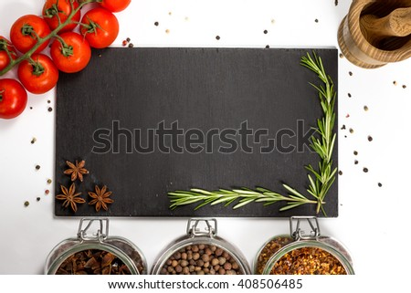 Spices and herbs in big glass jars. Food, cuisine ingredients. Wooden board with anise, rosemary. Cherry branch. Kitchen photography. - stock photo