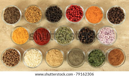 Spices and herbs in small glass bowls. Food and cuisine additives.