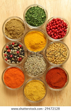 Spices and herbs in small glass bowls. Food and cuisine additives. Colorful natural ingredients. - stock photo