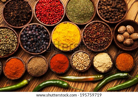 Spices and herbs in wooden bowls. Food and cuisine ingredients. - stock photo