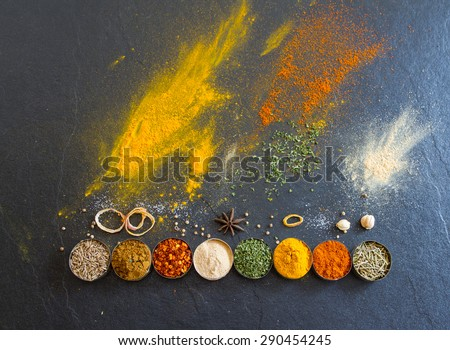 Spices and herbs on stone background, Top view indian mix spices and herbs difference ware on stone background with copy space for design spices, herbs or foods content. - stock photo