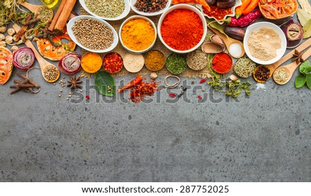 Spices and herbs on stone background, Top view indian spices and herbs difference ware on stone background with copy space for design spices, herbs or foods content. - stock photo