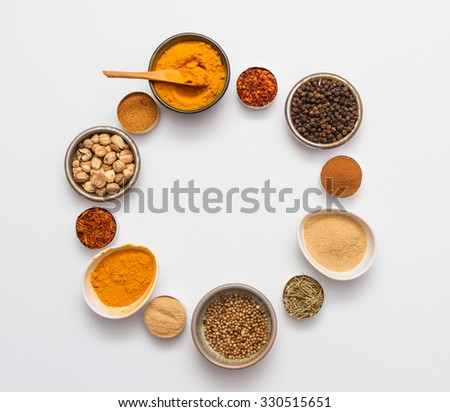 Spices and herbs on white background, Top view mix indian spices and herbs difference ware on white background with copy space for design vegetable, spices, herbs or foods content. - stock photo