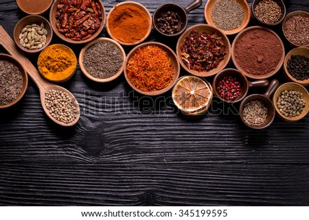 spices and herbs on wooden table.