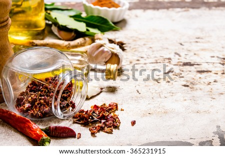 Spices and herbs - pepper, Bay leaf, garlic, coriander powder, and others. On rustic background. Free space for text . - stock photo