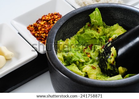 Spices and Ingredients for making avocado Guacamole - stock photo