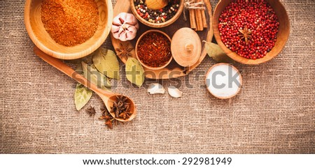 Spices and ingredients on a background of burlap cloth - stock photo
