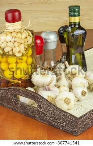 Spices and ingredients to prepare meat for grilling. Garlic, aromatic ingredients for flavoring food. Home remedy for colds and flu. Garlic marinated in olive oil. Seasoning food. - stock photo