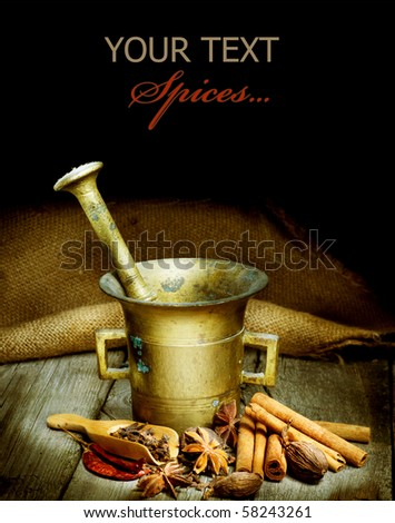 Spices and Mortar isolated on black.Vintage styled - stock photo