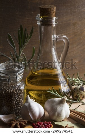 Spices and olive oil on a dark wooden background - stock photo