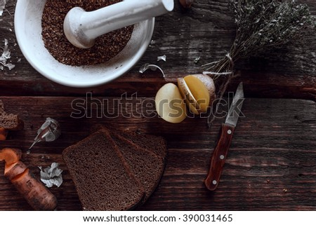 Spices and some kitchen stuff on a dark wooden table - stock photo