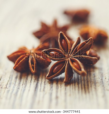 Spices. Anise stars on wooden surface - stock photo