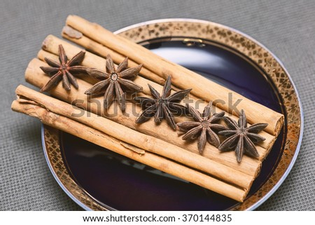 spices cinnamon and star anise in vintage style - stock photo
