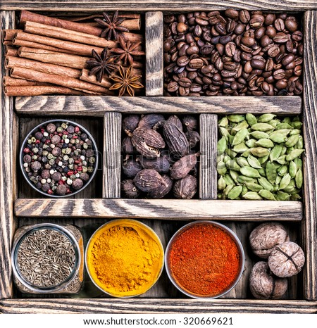 Spices, coffee and walnuts in the wooden box - stock photo