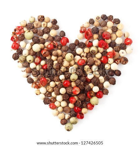 spices color pepper heart shape on white background