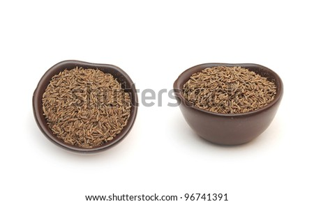 spices cumin seeds in a clay bowl isolated on a white background - stock photo