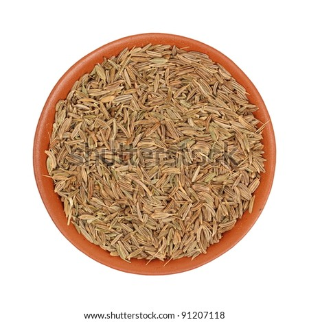 spices, cumin seeds, zira in a clay bowl, isolated, white background - stock photo