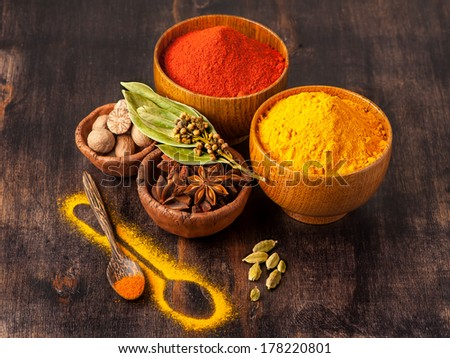 Spices curry, paprika, nutmeg, star anise, cardamom. Spice over Wood. - stock photo
