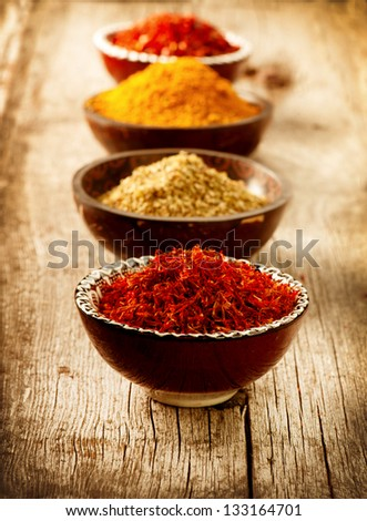 Spices Curry, Saffron, turmeric. Spice over Wood - stock photo