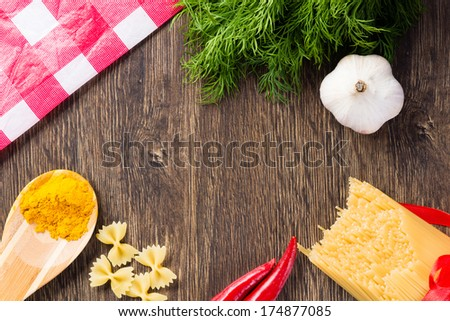 spices, dill, garlic, and chili paste on a wooden table top - stock photo