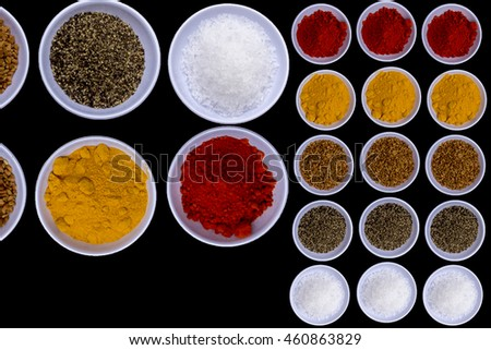Spices for herb and cooking,Top view spices on wood background,spices content,Various kinds of spices isolated on black