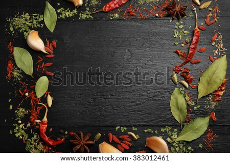 Spices frame on wooden table - stock photo