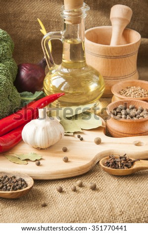 Spices, fresh vegetables and other ingredients to prepare healthy and tasty meal gourmet - stock photo