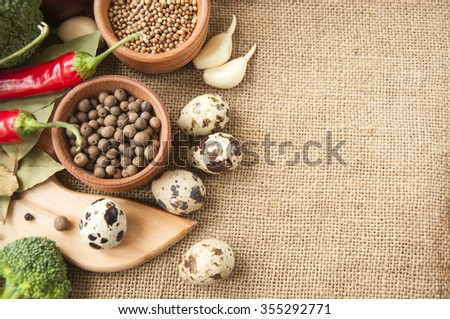 Spices, fresh vegetables, mushrooms, quail eggs, and other ingredients to prepare healthy and tasty meal gourmet - stock photo