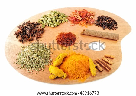 Spices from India  are arranged on a wooden palette