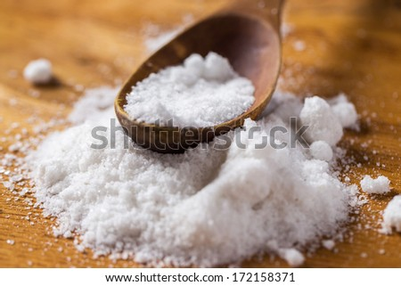 Spices. Heap of salt on the table - stock photo