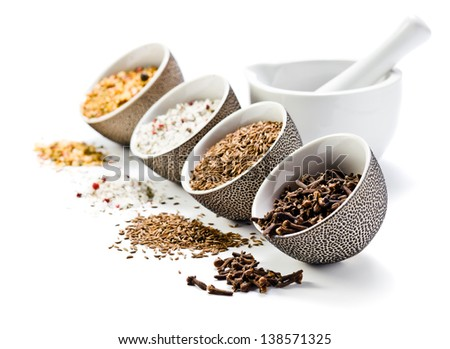spices in a small ceramic cups on a white background - stock photo