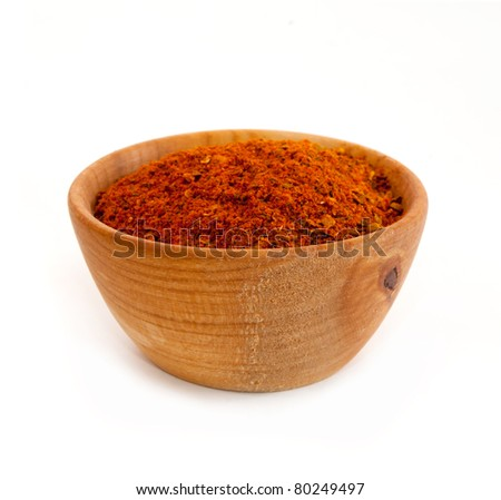spices in a wooden platter isolated on a white background