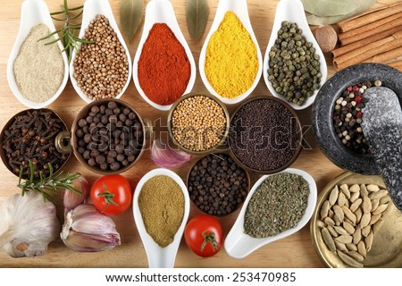 Spices in ceramic containers and metal bowls. Food and cuisine ingradients.