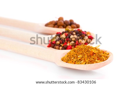 Spices in spoon isolated on white - stock photo