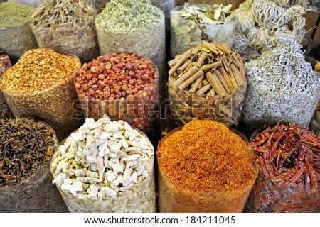 Spices in the spice souk in Dubai. Selective focus at the first row - stock photo