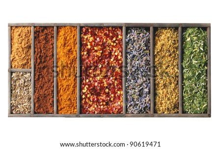 spices in wooden box isolated on white - stock photo